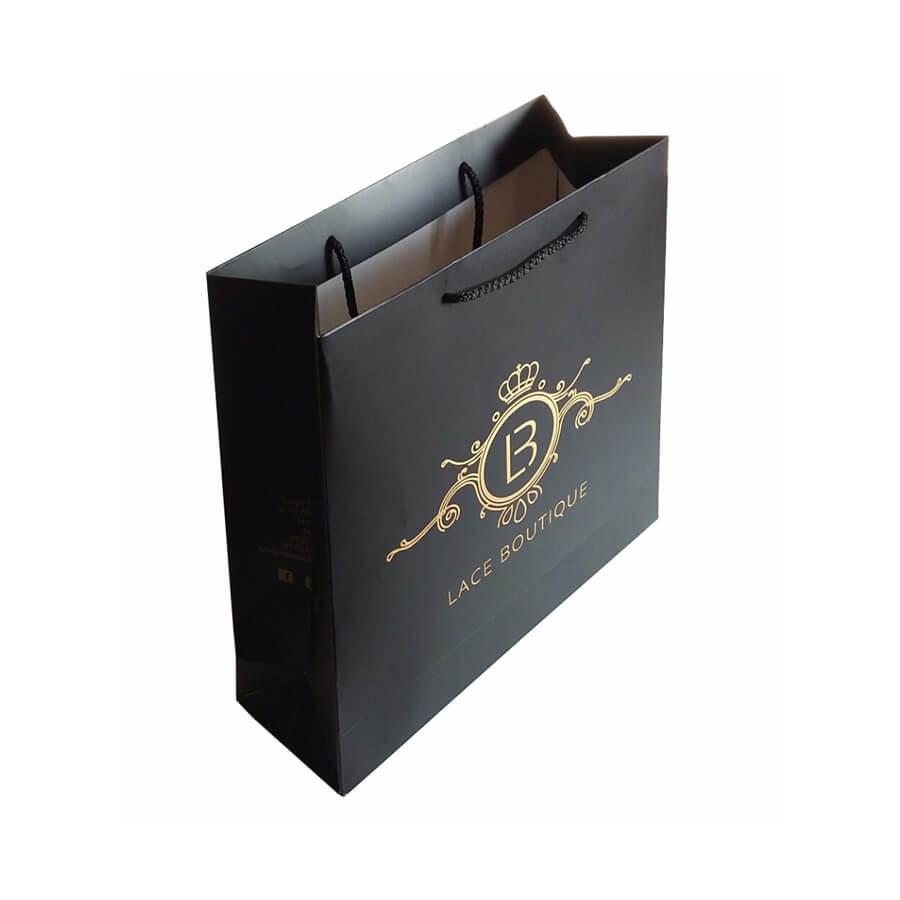 In túi giấy Ivory cho shop thời trang